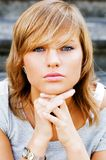 Beauty portrait. Young and beautiful woman with sad eyes siitting on the vintage stairs royalty free stock photos