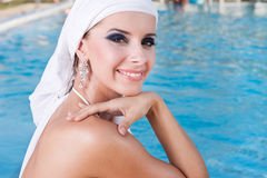 Beauty portrait. Beautiful Caucasian girl with a scarf on the Water Stock Photo