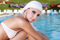 Beauty portrait. Beautiful Caucasian girl with a scarf on the Water Stock Photography