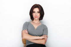 Beauty portrait of adult adorable fresh looking brunette woman with bob hairdo posing against white background showing emotion and. Beauty portrait of adult Royalty Free Stock Image