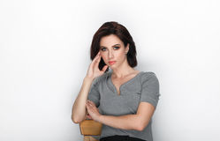 Beauty portrait of adult adorable fresh looking brunette woman with bob hairdo posing against white background showing emotion and. Beauty portrait of adult Stock Photography
