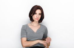 Beauty portrait of adult adorable fresh looking brunette woman with bob hairdo posing against white background showing emotion and. Beauty portrait of adult Royalty Free Stock Photography