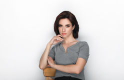 Beauty portrait of adult adorable fresh looking brunette woman with bob hairdo posing against white background showing emotion and. Beauty portrait of adult Royalty Free Stock Photo