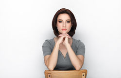 Beauty portrait of adult adorable fresh looking brunette woman with bob hairdo posing against white background showing emotion and. Beauty portrait of adult Royalty Free Stock Photos