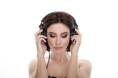 Beauty portrait of adult adorable fresh looking brunette woman with closed eyes gorgeous makeup dj headphones bob hairdo posing ag Stock Images