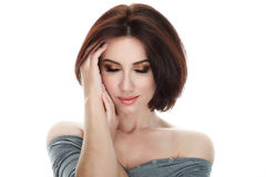 Beauty portrait of adult adorable fresh looking brunette woman with gorgeous makeup bob hairdo posing against isolated white backg Royalty Free Stock Photos
