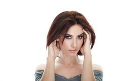 Beauty portrait of adult adorable fresh looking brunette woman with gorgeous makeup bob hairdo posing against isolated white backg. Beauty portrait of adult Royalty Free Stock Photography