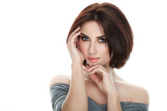 Beauty portrait of adult adorable fresh looking brunette woman with gorgeous makeup bob hairdo posing against isolated white backg. Beauty portrait of adult Stock Photography