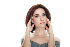 Beauty portrait of adult adorable fresh looking brunette woman with gorgeous makeup bob hairdo posing against isolated white backg. Beauty portrait of adult Stock Image