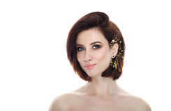 Beauty portrait of adult adorable fresh looking brunette woman with gorgeous makeup diy headpiece bob hairdo posing against isolat Royalty Free Stock Images