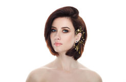 Beauty portrait of adult adorable fresh looking brunette woman with gorgeous makeup diy headpiece bob hairdo posing against isolat Royalty Free Stock Photos