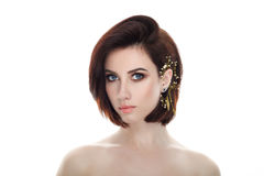 Beauty portrait of adult adorable fresh looking brunette woman with gorgeous makeup diy headpiece bob hairdo posing against isolat. Beauty portrait of adult royalty free stock image