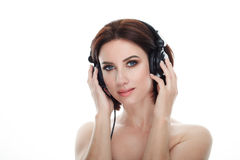 Beauty portrait of adult adorable fresh looking brunette woman with gorgeous makeup dj headphones bob hairdo posing against isolat. Beauty portrait of adult Stock Image