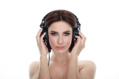 Beauty portrait of adult adorable fresh looking brunette woman with gorgeous makeup dj headphones bob hairdo posing against isolat. Beauty portrait of adult Royalty Free Stock Photography