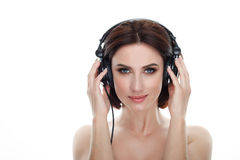 Beauty portrait of adult adorable fresh looking brunette woman with gorgeous makeup dj headphones bob hairdo posing against isolat Stock Images