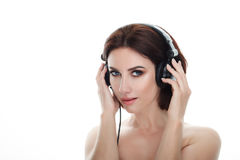 Beauty portrait of adult adorable fresh looking brunette woman with gorgeous makeup dj headphones bob hairdo posing against isolat Royalty Free Stock Image
