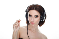 Beauty portrait of adult adorable fresh looking brunette woman with gorgeous makeup dj headphones bob hairdo posing against isolat. Beauty portrait of adult Royalty Free Stock Photos