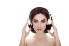 Beauty portrait of adult adorable fresh looking brunette woman with gorgeous makeup wireless headphones bob hairdo posing against. Beauty portrait of adult Royalty Free Stock Images