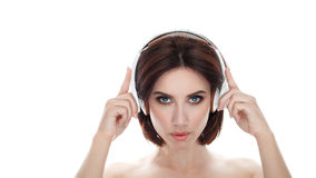 Beauty portrait of adult adorable fresh looking brunette woman with gorgeous makeup wireless headphones bob hairdo posing against Royalty Free Stock Photography