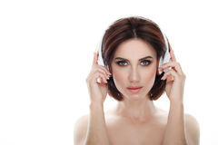 Beauty portrait of adult adorable fresh looking brunette woman with gorgeous makeup wireless headphones bob hairdo posing against Royalty Free Stock Photo