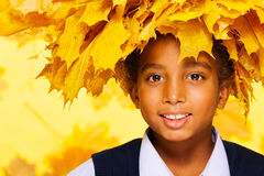 Beauty portrait of African boy in maple wreath Stock Photo