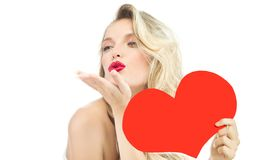Woman beauty red heart valentine`s love kiss. Beauty portrait of attractive young caucasian  woman blond  on white studio shot red  lips  face long hair head and Stock Photos