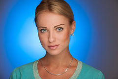 Beauty portrait of attractive young woman with blue aura in back Royalty Free Stock Images