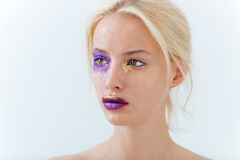Beauty portrait of attractive young woman with creative makeup. Over white background Stock Photography
