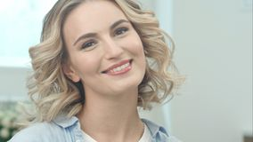 Beauty portrait of beautiful blonde woman smiling at camera stock photos