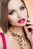 Beauty portrait of beautiful lady with bright makeup, gold, bright fuchsia lips. Beauty, fashion, grooming. Stylish Royalty Free Stock Photos