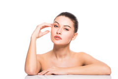 Beauty Portrait. Beautiful Spa Woman Touching her Face. Perfect Fresh Skin. Isolated on White Background. Pure Beauty Stock Images