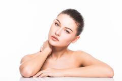 Beauty Portrait. Beautiful Spa Woman Touching her Face. Perfect Fresh Skin. Isolated on White Background. Pure Beauty Stock Photo