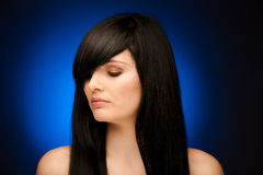 Beauty portrait of beautiful woman with black hair and blue eyes Royalty Free Stock Image