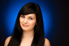 Beauty portrait of beautiful woman with black hair and blue eyes Stock Image