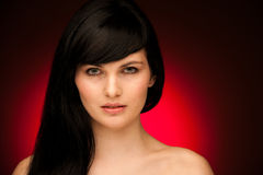 Beauty portrait of beautiful woman with black hair and blue eyes Royalty Free Stock Photos