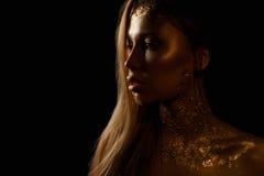 Beauty portrait of beautiful woman. gold portrait. Royalty Free Stock Photos