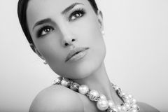 Beauty portrait. Beautiful woman portrait with stylish pearl necklace, black and white royalty free stock images