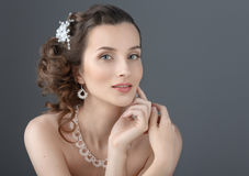 Beauty Portrait. Beautiful Woman Touching her Face. Perfect Fres Royalty Free Stock Photography