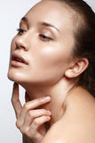 Beauty Portrait. Beautiful Woman Touching her Face. Perfect Fres Royalty Free Stock Images
