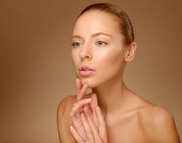 Beauty Portrait. Beautiful Woman Touching her Face. Perfect Fres Royalty Free Stock Image