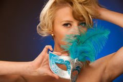 Beauty portrait of Beautiful young blonde woman with venice carn Stock Photos