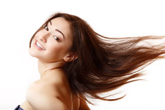 Beauty portrait of beautiful young smiling woman happy ecstatic. Gesturing success with flying long brown hair. Isolated on white stock images