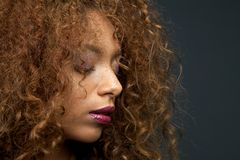 Beauty portrait of a beautiful young woman with curly hair. Close up beauty portrait of a beautiful young woman with curly hair Royalty Free Stock Images