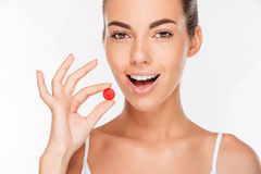 Beauty portrait of a beautiful young woman taking pill Royalty Free Stock Photo