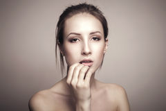 Beauty Portrait Of Beautiful Young Woman Touching her Face Stock Photography
