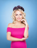 Beauty portrait of a blond girl with curly hair Royalty Free Stock Image