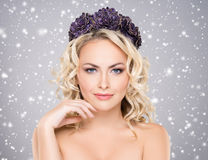 Beauty portrait of a blond girl with curly hair Royalty Free Stock Photography