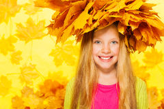 Beauty portrait of blond girl in maple wreath Stock Image