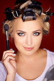 Beauty portrait of a blond wearing curlers Stock Images
