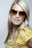 Beauty portrait of a blond woman with sunglasses Stock Photography